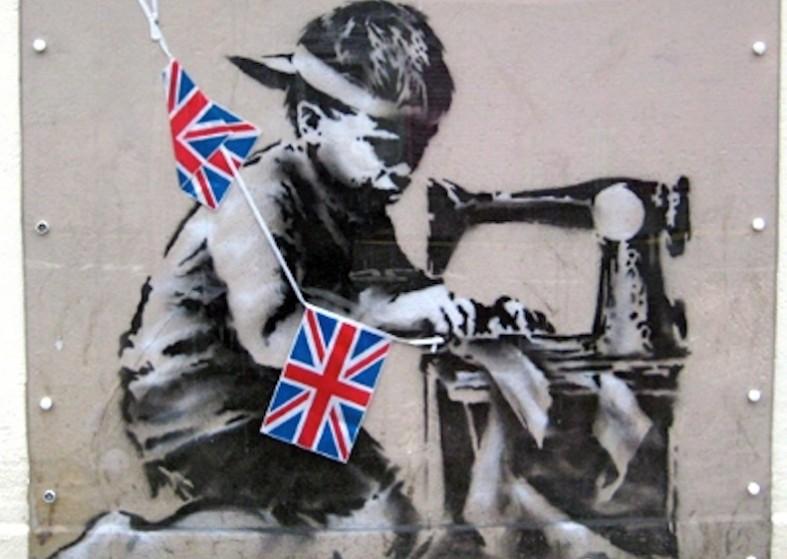 Banksy - boy sewing flags