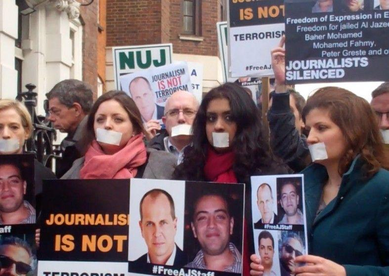 Peter Greste protestors taped mouths