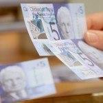 Plastic five pound notes