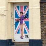 Queen in a doorway