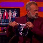 Graham Norton displays swimming trunks