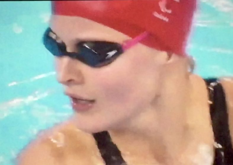 Hannah Russell races to backstroke gold