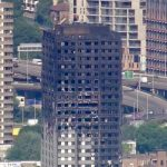 smouldering Grenfell Tower
