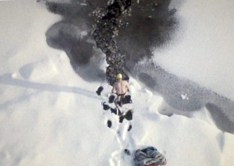 Wild Swimmer Goes for a Dip in Frozen Loch
