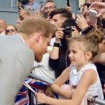 Prince Harry chats to young fan