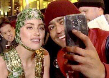 Amber Heard enjoys a selfie
