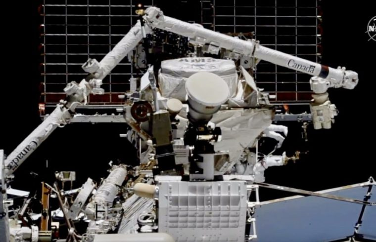 astronauts working